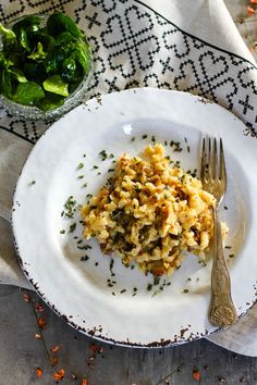 Käsespätzle, Kasnocken, Käsknöpfle: An Austrian creamy cheese noodles dish.