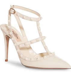 White pyramid studs keep the look fresh, modern and ultra-versatile on these iconic T-strap pumps.