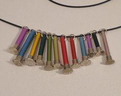 Needle top pendant