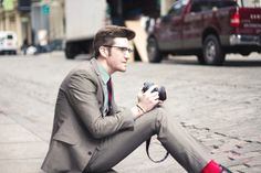 James Nord. Red socks/personal style/a grey suit that looks good on somebody.