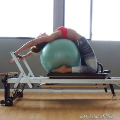 """Happy Monday! """"BALL ON REFORMER""""! — Its a full body-opener that stretches the shoulders, chest, #spine, and thighs. It's great for beginner and intermediate clients. Just make sure there is no strain on the neck. I always make a point to do this stretch if I've done a lot of #core work, to release the hip flexors so it doesn't pull on my lower back. * www.mypilayes-place..com"""