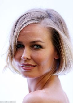 Blonde beauty: The Australian model and wife of Sam Worthington's hair was styled to perfection with a natural wave