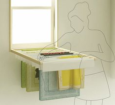 Blindry - clothes rack window shade - via Dornob.  What a great idea for small space living