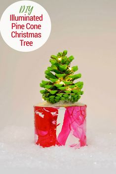 to make a cute illuminated pine cone Christmas tree in a marble pot. This colorful Christmas tree complete with copper lights will brighten up any desk. Pine Cone Christmas Tree, Colorful Christmas Tree, Little Christmas, Christmas Lights, Christmas Holidays, Christmas Decorations, Christmas Ideas, Christmas Ornament, Holiday Ideas