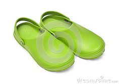 Green garden clogs / beach clogs  on white background w/ path