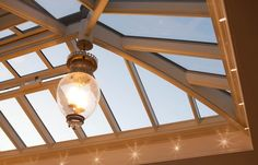 Roof lanterns offer glorious natural lighting in the day time. For the same accenting through the evening hours, consider adding a ceiling light to the glazed area.