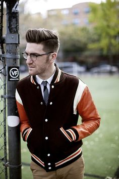 jamesnord:  Got this varsity jacket at Sweet Lorain in Cleveland, but like most vintage pieces for men the tailoring was way off. I went to a guy on the Lower East Side who does leather and had him take 4.5 inches out of thesleevesand 2.5 inches out of the body. The result, a well tailored 40 year old varsity jacket for under $100 all in. Pants by Unis, Tie by Penguin, Hair cut at Dickson Hairshop, photo snapped by Megan Collins.
