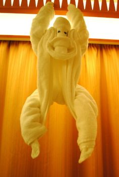 Towel origami monkey. Learn how to make towel origami at: http://FoldingMagic.com