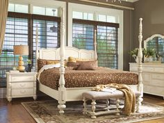 Beautiful Southern style. Furniture by Paula Deen (love that four poster bed in cream)