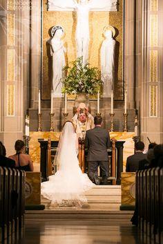 Anna and Spencer Photography, Atlanta Documentary Wedding Photographers. Communion at a Catholic Wedding Ceremony.