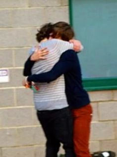 This picture means so much to me. Harry's holding onto Louis for dear life. Like he's going to leave forever.