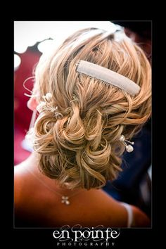Love Love Love this!!!! the velcro barrette is for her veil, I won't be needing that, but I love the simplicity of the updo