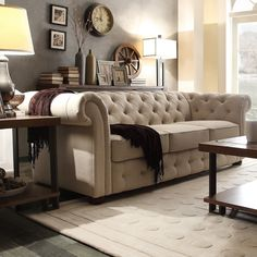 Add graceful seating to your home with the Knightsbridge Chesterfield. Showcasing tufted back and rolled arms in beige linen, along with bun feet finished in dark brown, this elegant padded seat sofa can provide plenty of support and comfort in style.