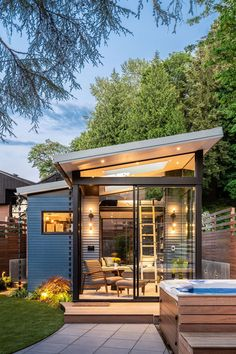 Modern Backyard Reading Shed With Skylights And Large Windows - The new backyard retreat was primarily designed as a reading space, hence the glass walls and skyli - Backyard Office, Backyard Studio, Modern Backyard, Garden Office, Backyard Retreat, Retreat House, Garden Modern, Backyard Cottage, Backyard Sheds