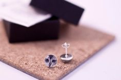Tiny sterling silver cat face stud earrings. Gift boxed and ready to give to your cat loving friend. £16 - Etsy.