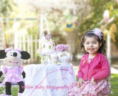 Two year old tea party photo shoot with Minni Mouse and mini white cake with roses. Newborn, first year photography