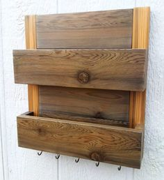 Too cute! Hubby could make it, there could be three slots, one says his, one says hers and then one for theirs. Hooks at the bottom could hold keys!!
