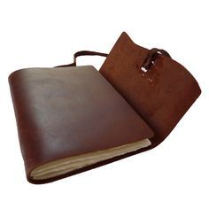 This sturdy, hand sewn notebook was constructed to take a beating and travel the globe. The unique flap tie closure is stylish and secure. The hand-stitched binding can fold in half without breaking.
