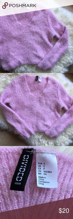 """Fluffy Pink Cropped Sweater Very cute cropped sweater, reminds me of the outfits in Clueless! V-neck, soft and stretchy. Body length 16 1/2"""", bust 32"""". Tagged as ASOS since it looks more like their styles! ASOS Sweaters V-Necks"""