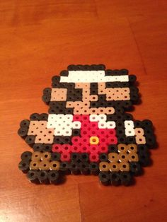 Hey, I found this really awesome Etsy listing at https://www.etsy.com/listing/185813821/super-mario-perler-bead-sprite-keychain
