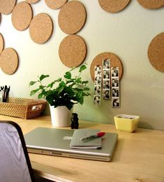 """organic-shaped """"cork board"""" — which is about 15 packs of cork trivets from Ikea nailed to the wall"""