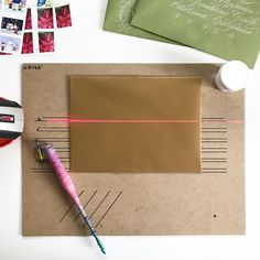 """DIY Laser Liner! I had a couple of people asking about my method for envelope addressing. I currently don't have any laser liners, so this worked for a small number of envelopes! ▪️ Mark your xheight/baseline on a chipboard (I got a big pack from amazon that I use for my print orders). I mark at least 4 baselines and 1 line to know where to place the envelope ▪️After playing around with different heights, I liked spacing my baselines 5/8"""" apart. That gave me room to flourish and didn't make…"""