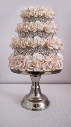 I love the pearls covering the cake! Such a beautiful yet different texture and look! Gorgeous! I'd get it without the ruffles though!