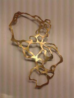 Decay skeletal brass piece. Lisa Sabina.