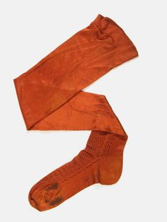 1870 Stockings Medium: silk One of a pair of stockings, chestnut knitted silk with openwork fronts, darned.