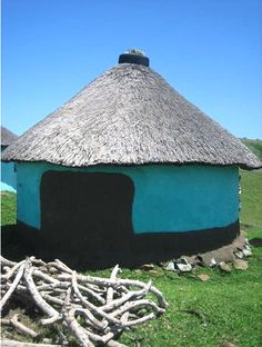 These mud huts are dotted around the hills of the Transkei, South Africa and they are ingenius because of that little patch on the back that is unpainted. It catches the sun in the late afternoon ensuring that the hut absorbs more heat and therefore stays warmer for when night falls. Beautifully simple.