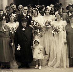 Iris Hunt, aged two, holding the hand of the mother of John Parr at a wedding in 1942...