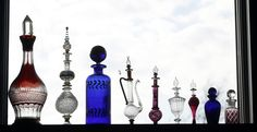Pretty perfume bottles all in a row | MLive.