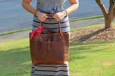 THE DENVER leather tote is handcrafted to order at my workshop in Georgia. Please allow 2-3 weeks production time, plus shipping.  On a recent trip to Denver, I wanted to avoid checking any bags, so I designed this leather tote to serve as my personal item for the carry on. Its great because you can pack a fair amount of clothes in it or use it to carry your tech gadgets, toiletries, books, etc. Its a great all around weekender tote. If you like the overall design of this bag but want…