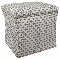 """Upholstered storage ottoman with nailhead trim and a pine wood frame. Handmade in the USA.   Product: Storage ottomanConstruction Material: Solid pine, polyurethane and polyester foamColor: Steel maconFeatures:  Handmade in the USALift off lid Dimensions: 17"""" H x 19"""" W x 19"""" DCleaning and Care: Spot clean only"""