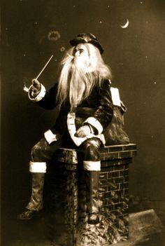 Santa taking a smoke break! Early 1900s Christmas portrait postcard