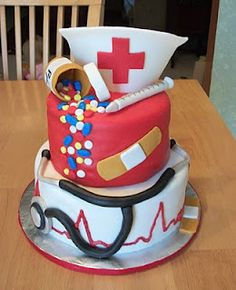 Cake with nurse's cap, pill bottle, Band Aid, syringe, stethoscope