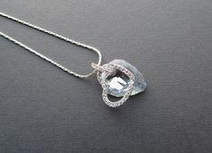 Ketting met een mooie kristallen swarovski rock hanger en een verzilverd hart met strass steentjes.