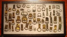 .Lot of buckles. Mainly 14th-15th century. Most retaining the plates used to mount them to the belt. Some have separate mounting plates, some have integral plates. excavated. For the most part 14th-15th cent.