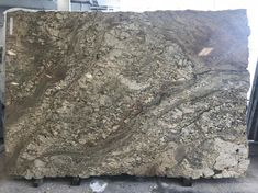 New Bundle of #TyphoonBordeaux, this piece of #granite has #green #veining with #cream and #taupe as the base color. Here at #QuailtyStones we have over #400 different #colors to choice from, come in today and see are warehouse.