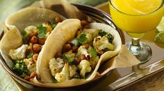 Veggie lovers will devour this new take on a vegetarian taco filled with roasted cauliflower, crispy chickpeas and flavorful cilantro pesto.  As an added bonus, it's also gluten-free. Pair with Frozen Mango COCOritas.