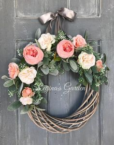 This elegant wreath is designed with beautiful faux lambs ears, gray green filler and peachy pink cottage roses. It is designed on a whitewashed willow wreath and hangs from a satiny gray ribbon. Simple and oh so lovely, this gorgeous design will look wonderful inside your home or on