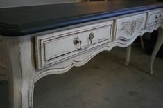 The original, dark stain on this table masked the carvings. After painting the table with Pure White Chalk Paint, I used distressing and dark wax to make ...