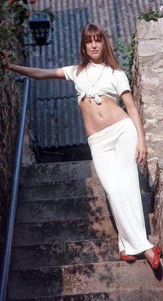 Jane Birkin in a white knotted tee and loose linen white pants