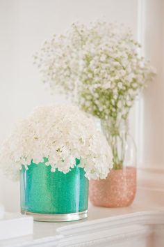 DIY Glitter Vases | Glass containers, glitter, foam brush and ModPodge | Can be used to hold flowers on a countertop, makeup brushes on a vanity, or pens and pencils on a desk.