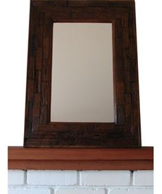 @Overstock.com - Large Teakwood Wall Mirror (Thailand) - This  large Taiwanese wall mirror is easily distinguished from its competition due to its strong design and stylish presence. This mirror is constructed from recycled teakwood and finished in a beautiful dark brown that is sure to catch the eye.  http://www.overstock.com/Worldstock-Fair-Trade/Large-Teakwood-Wall-Mirror-Thailand/2162520/product.html?CID=214117 $98.99