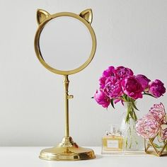 A cat mirror so you can always make sure your hair and makeup are purrrfect. | 32 Things To Make Your Bedroom Cute AF