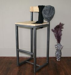Handmade metal bar stool. This is a great bar stool out of steel and the wood. Its beautiful wood, that is clear and clean. I shined up the steel a little to make it pop, and it does.Handmade industrial metal and wood bar stool chair by jreal