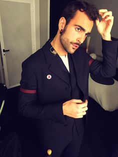 Captured backstage at X Factor Italy, Italian singer Marco Mengoni was spotted in a tailored three-piece suit from Z Zegna's fall-winter 2014 collection.