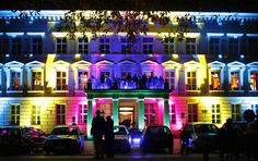 """Pedestrians look at the Palais am Festungsgraben, an illuminated building in Berlin, Germany, during the """"Festival of Lights"""" on October 14, 2008"""