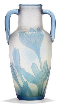 A DAUM FRÈRES CAMEO GLASS AND WHEEL-CARVED TWIN-HANDLED VASE - CIRCA 1900